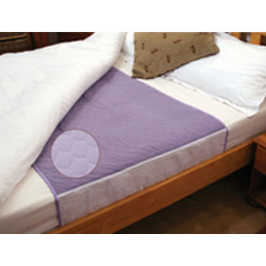 Deluxe washable bed pad with tucks.